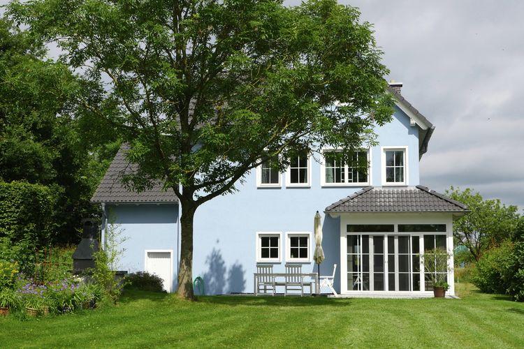 Prachtige ruime woning met sauna, moderne inrichting en enorme, parkachtige tuin