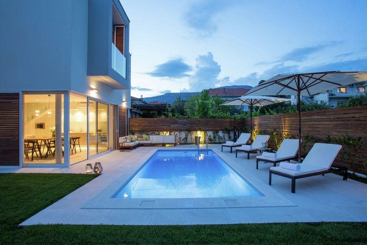 Dalmatie Vakantiewoningen te huur Buitengewone villa met verwarmbaar zwembad, omheinde tuin, op 50 meter van het strand