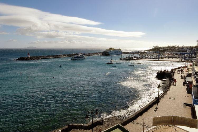 Playa-Blanca Vakantiewoningen te huur Appartement met fantastisch uitzicht op Papagayo-baai, in centrum Playa Blanca