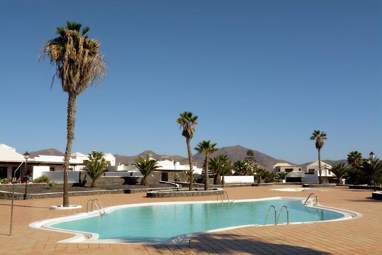 Playa-Blanca Vakantiewoningen te huur Gezellig vakantiehuis met gedeeld zwembad in rustig gedeelte van Playa Blanca
