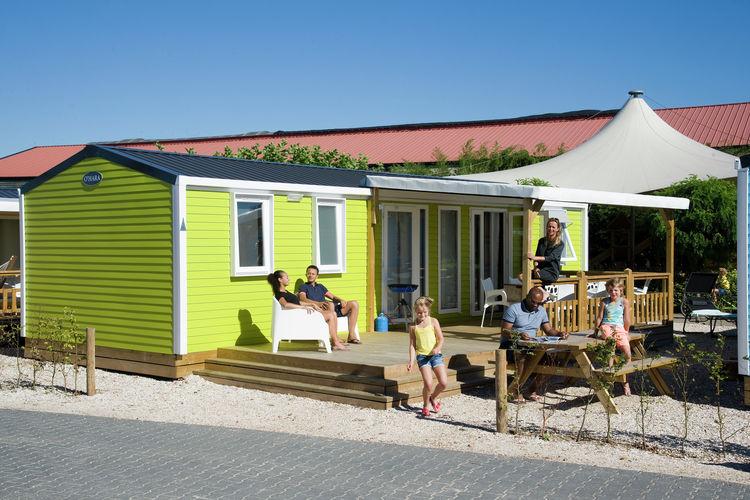 Maurik Vakantiewoningen te huur Mooie lodges, bijna direct aan het meer en strand, gelegen op bijzonder park