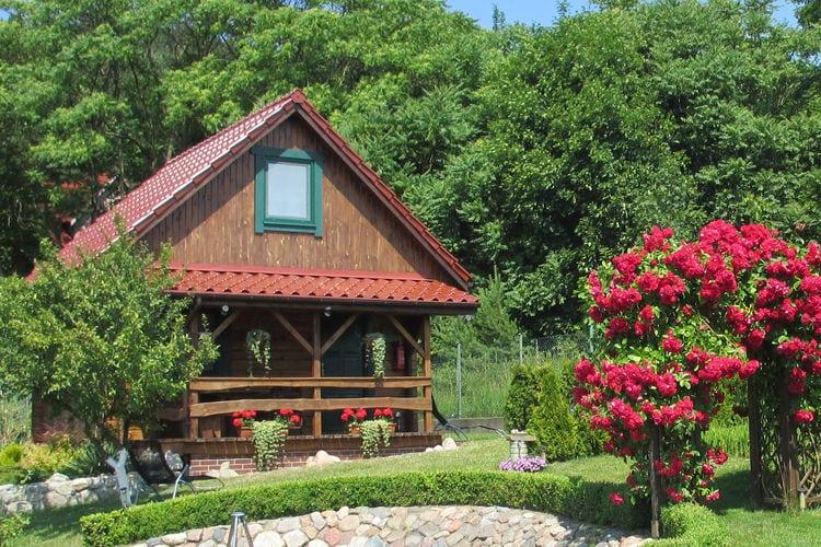 wepo Vakantiewoningen te huur Charmant huis op een heuvel met uitzicht op het meer, 5 km van Międzyzdroje