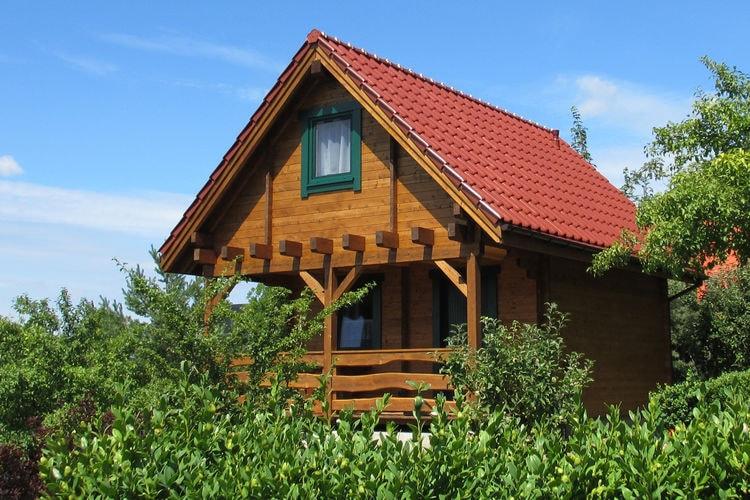 wepo Vakantiewoningen te huur Huis op een heuvel, omringd door bos, tuin, uitzicht op het meer - 5 km van Międzyzdroje