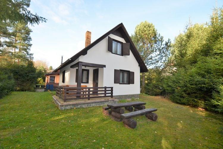 Vrijstaand huisje met fijne tuin, open haard en overdekt terras, aan vismeer