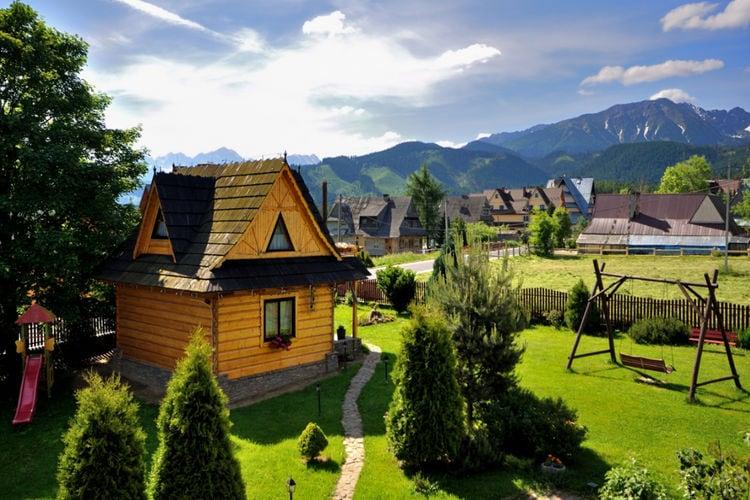 Polen Chalets te huur Een fantastisch huisje met uitzicht op het Tatragebergte. Sauna, jacuzzi.