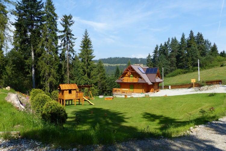 Polen Chalets te huur Knus appartment 1(totaal uit 4) in houten cottage met zoutgrot in de tuin