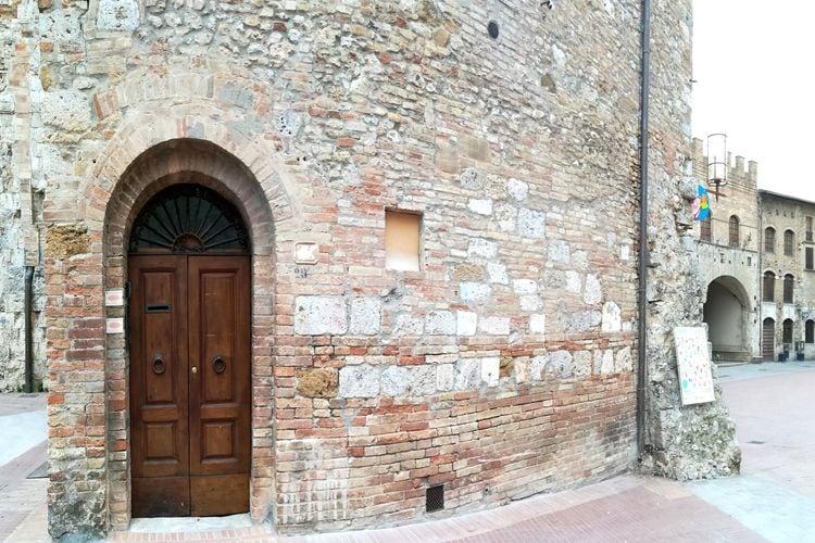 Vakantiewoning  met wifi  San Gimignano  Gezellig apartement recht in het centrum op piazza del Duomo van San Gimignano