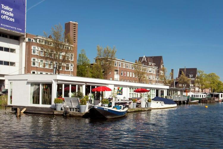 Vakantiewoning  met wifi  Amsterdam  B&B op een schitterende woonboot in de Amstel vlakbij de Albert Cuypmarkt
