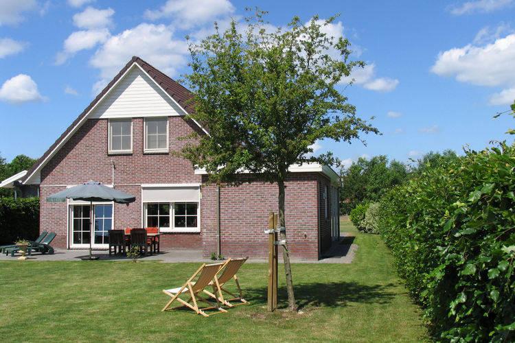 Comfortabele vakantiewoning op buitenplaats met privacybiedende, grote tuin